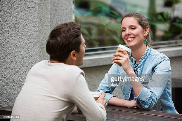young couple having coffee - older woman younger man stock photos and pictures