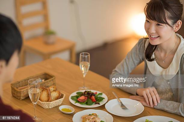 Young couple having dinner