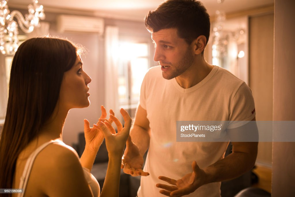 Young couple having disscusion at home : Stock Photo