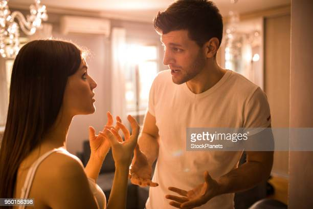 young couple having disscusion at home - couple arguing stock photos and pictures