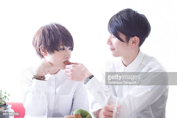 Young couple having donuts