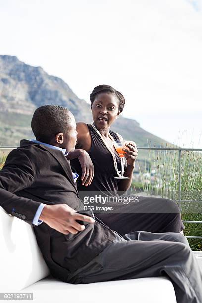 Young couple having drinks, Cape Town, South Africa