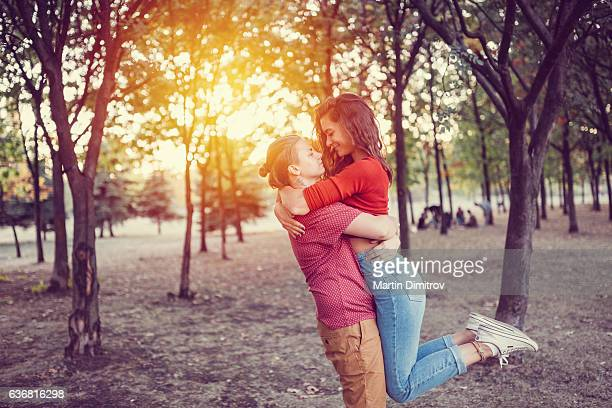 young couple having fun among nature - lesbian dating stock pictures, royalty-free photos & images