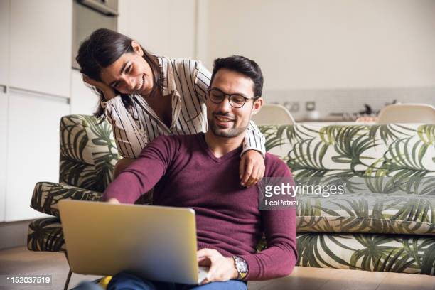 young couple having fun at home - couple stock pictures, royalty-free photos & images