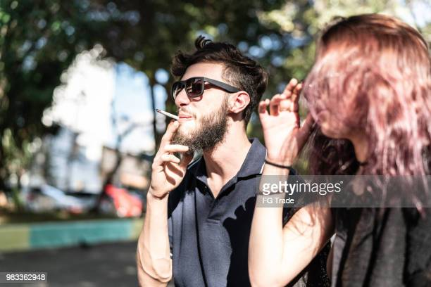 young couple having fun at park - smoking issues stock pictures, royalty-free photos & images