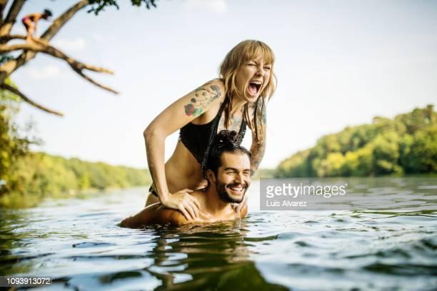 young couple having fun at the lake - 25 29 años fotografías e imágenes de stock