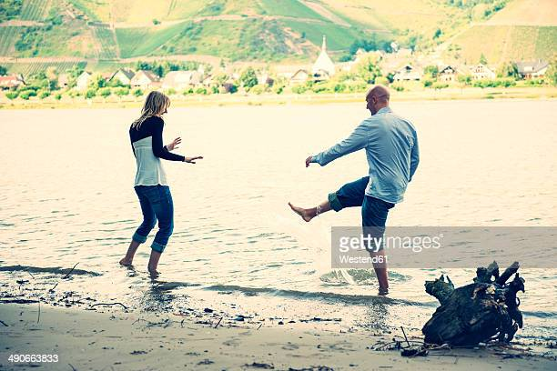 Young couple having fun at waterside of Rhine river