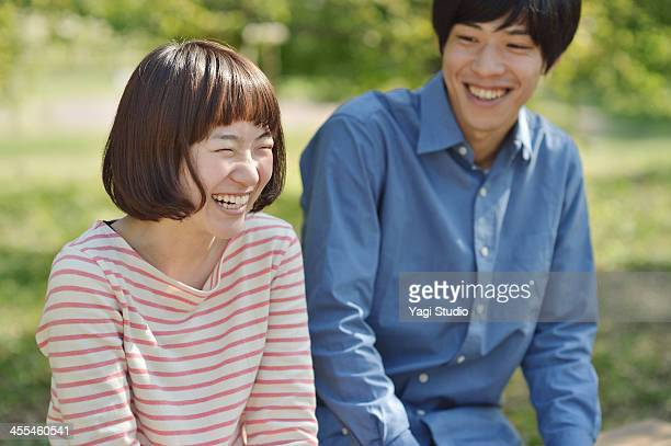 Young couple having fun in the green