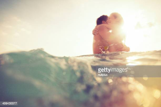 young couple having fun in the sea