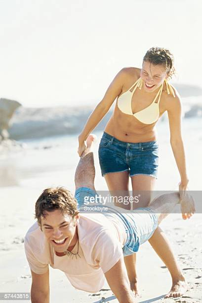 Young couple having fun on the beach