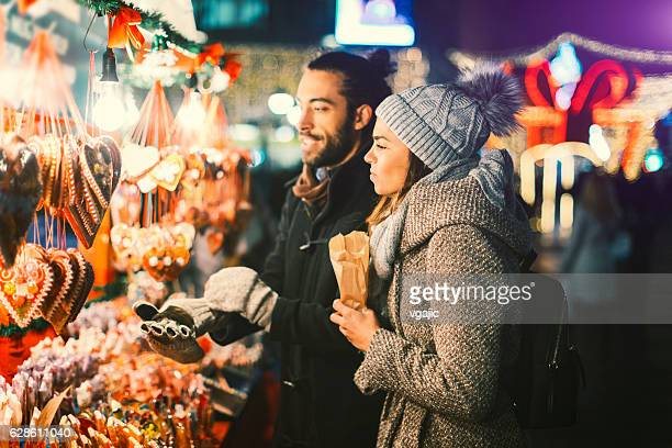 Young Couple Having Fun Outdoors At Christmas Time