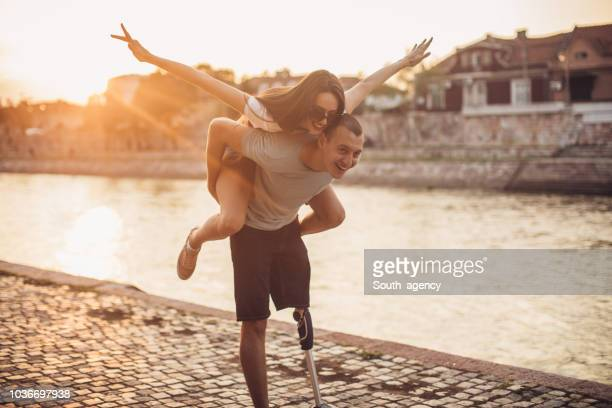young couple having fun - amputee stock pictures, royalty-free photos & images