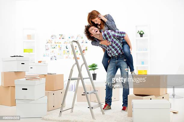 Young Couple Having Fun Renovating House.