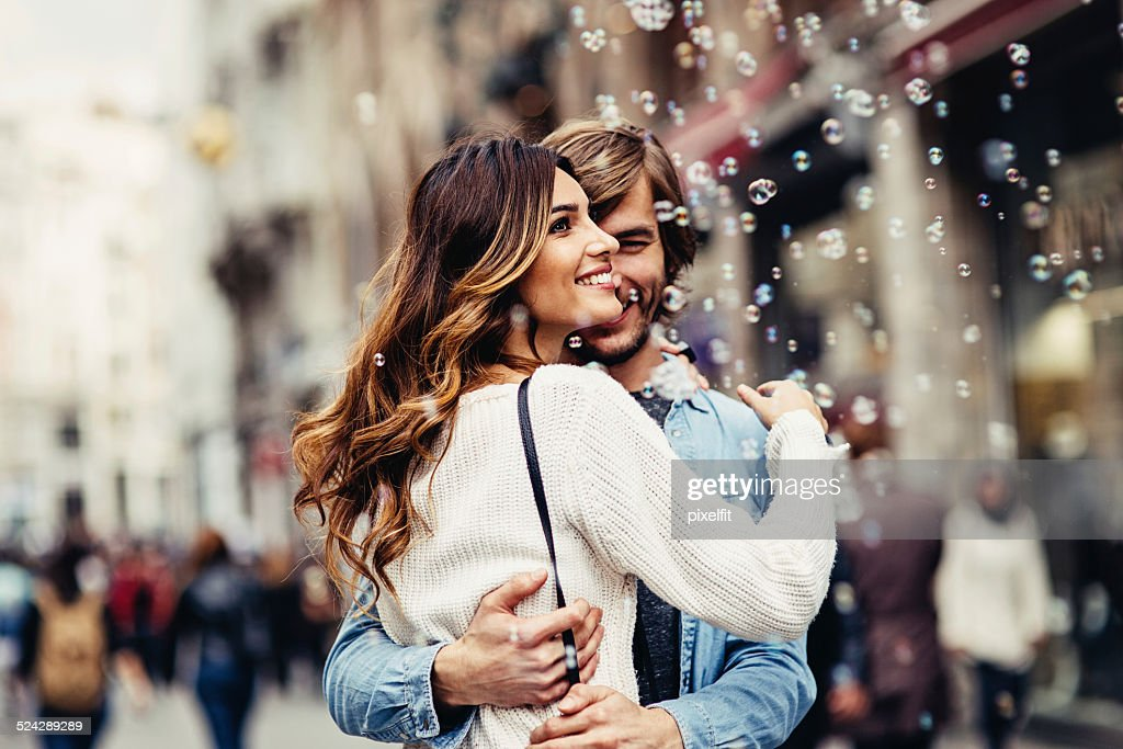 Young couple having great time on the street : Stock Photo