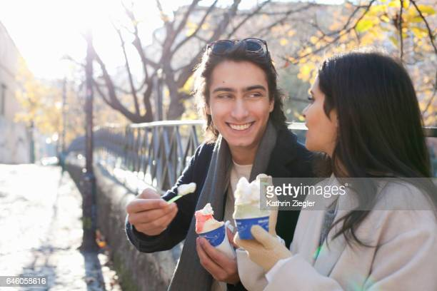 Young couple having ice cream in wintertime