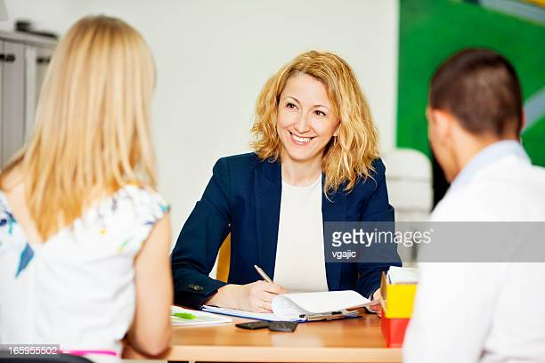 Young Couple Having Meeting With Financial Advisor.