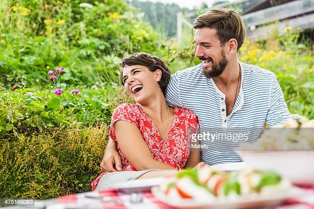 Young couple having picnic lunch, Tyrol, Austria