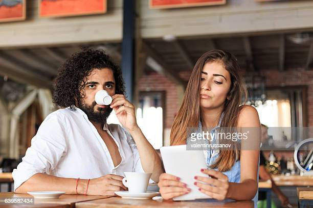 Young couple having probles and drinking coffee in cafe