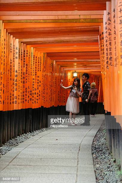 Young Couple Having Selfie In Fushimi Inari, Kyoto, Japan