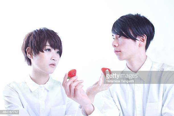 Young couple having strawberry