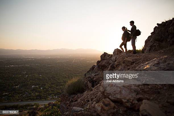 A young couple hike above Salt Lake City