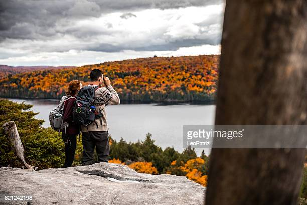Young couple hiking in mountain looking at view