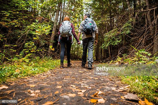 Young couple hiking in mountain on a footpath