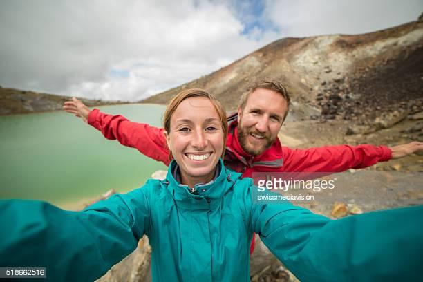 Young couple hiking on Tongariro Alpine Crossing take selfie portrait