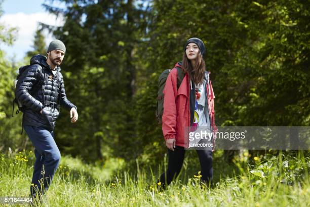 young couple hiking together in mountains - valley stock pictures, royalty-free photos & images