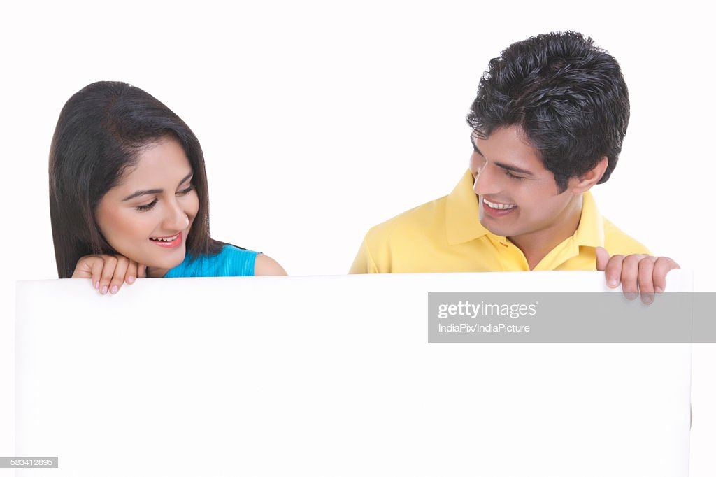 Young couple holding a board : Stock Photo