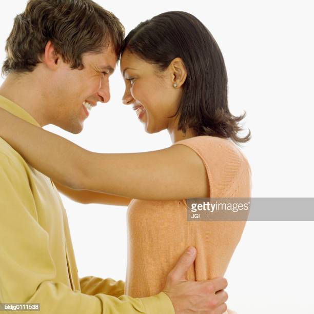 Young couple holding each other smiling