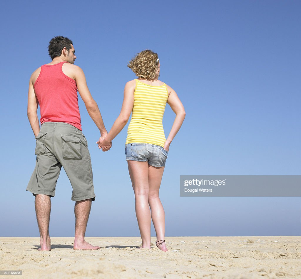 Young couple holding hands at beach. : Stock Photo