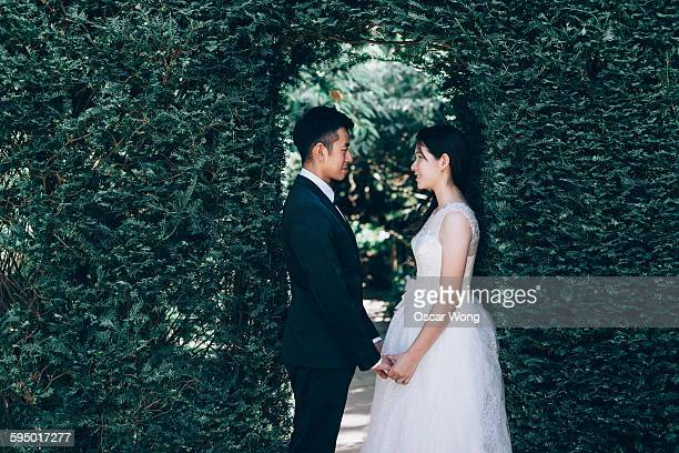 Young couple holding hands in garden