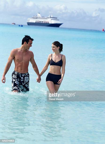 Young Couple Holding Hands in the Gulf of Mexico