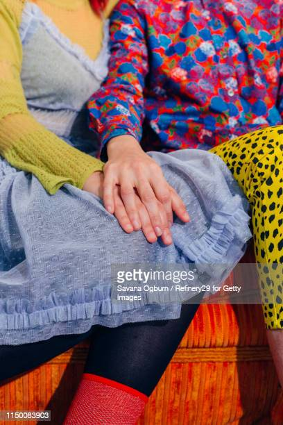 young couple holding hands - noapologiescollection stock pictures, royalty-free photos & images