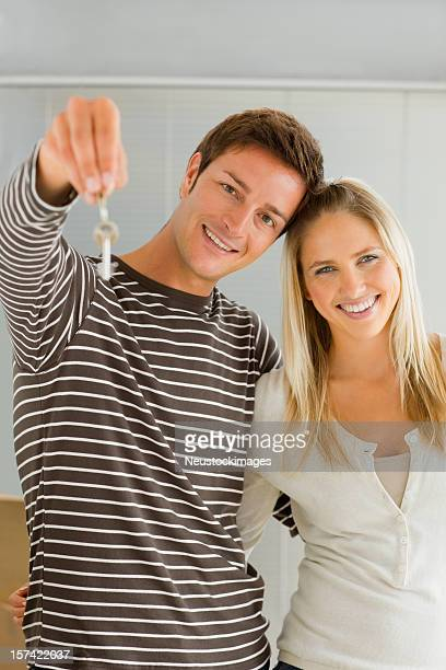 Young couple holding keys
