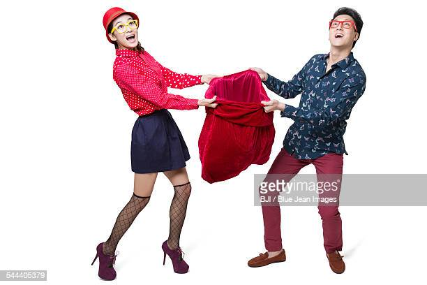 Young couple holding large gift bag