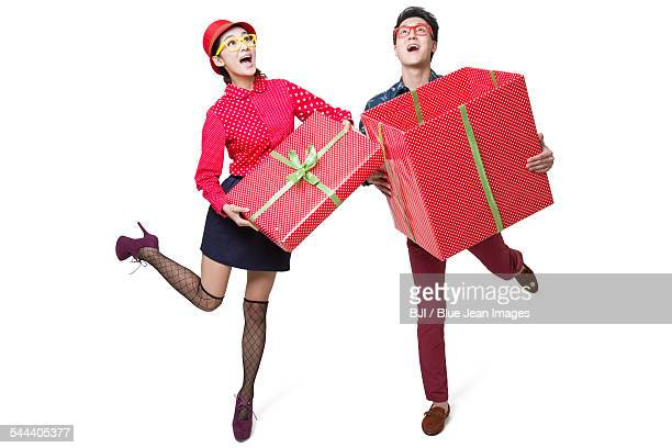 Young couple holding large gift box