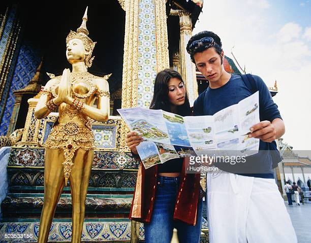 Young Couple Holding Map by Palace
