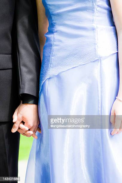 Young couple holds hands