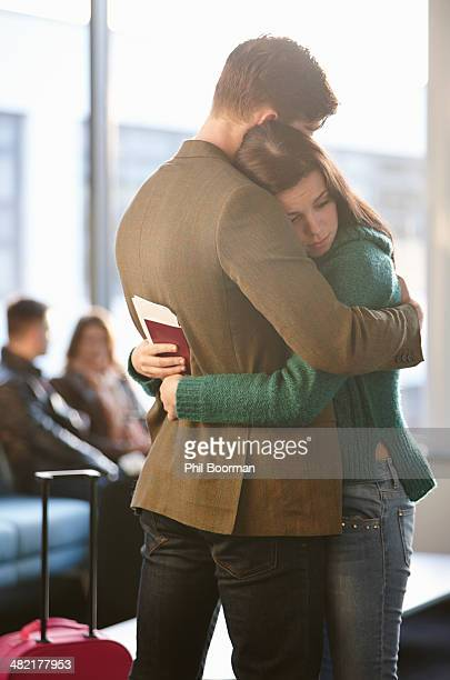 Young couple hugging in airport