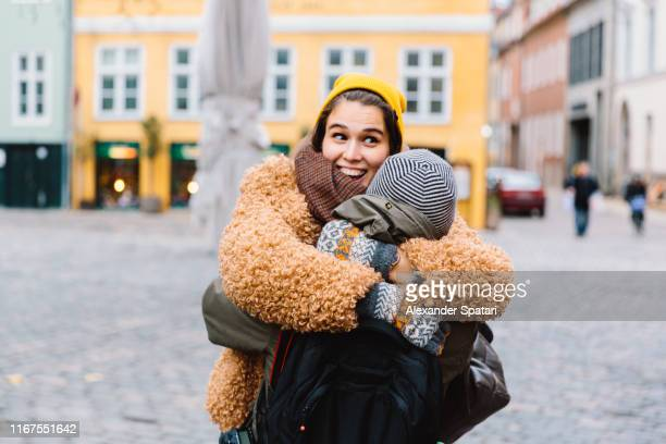 young couple hugging, laughing and having fun - city break stock pictures, royalty-free photos & images