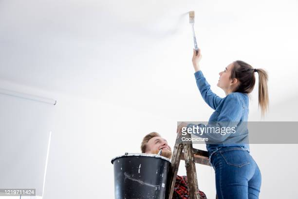 young couple improving their home. - ceiling stock pictures, royalty-free photos & images