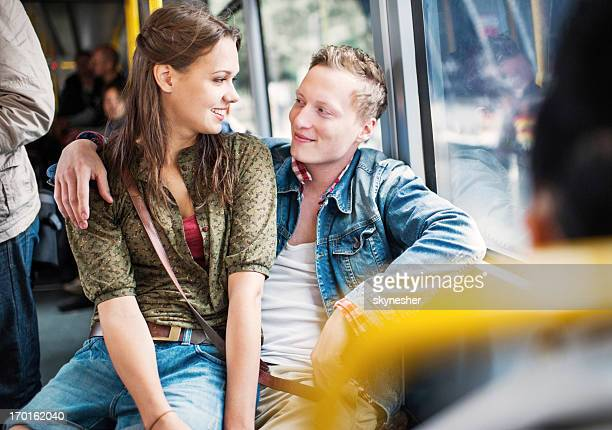 Young couple in a bus.