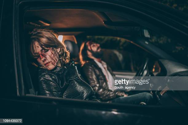 young couple in a car accident - bloody car accidents stock pictures, royalty-free photos & images