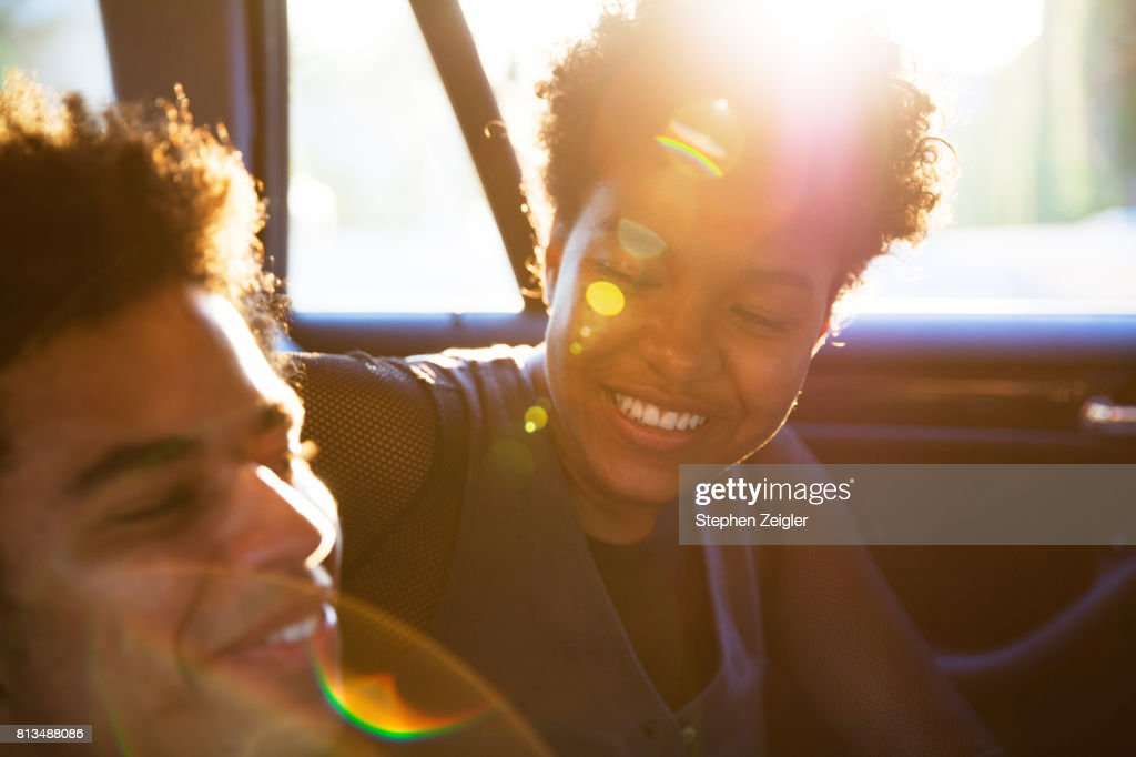 A young couple in a car : Stock Photo