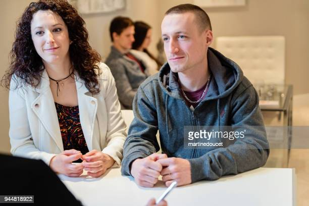 "young couple in a consultation in small office. - ""martine doucet"" or martinedoucet stock pictures, royalty-free photos & images"