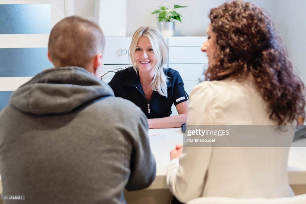 Young couple in a consultation in small office. : Stock Photo