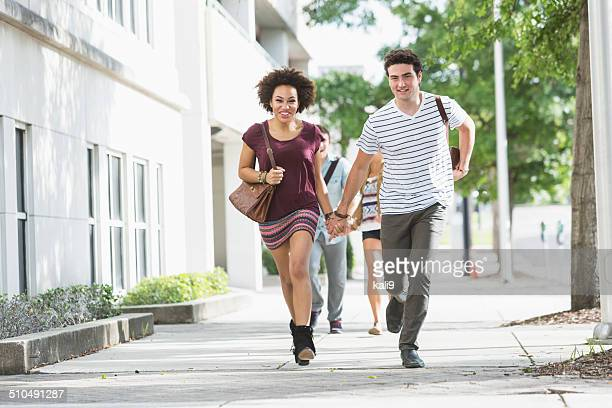 Young couple in a hurry
