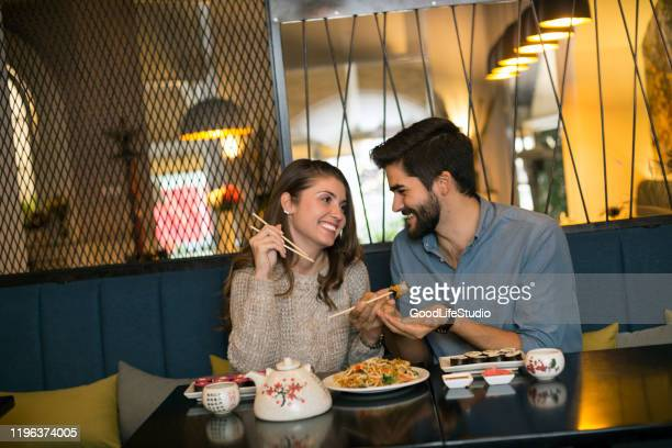 young couple in a restaurant - 20 29 years stock pictures, royalty-free photos & images